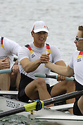 Munich, GERMANY, 2006, Thorsten Englemann [right] turns to, grip hands. with Ulf Siemes, before the start of the men's eights heat at the FISA, Rowing, World Cup,  held on the Olympic Regatta Course, Munich, Thurs. 25.05.2006. © Peter Spurrier/Intersport-images.com,  / Mobile +44 [0] 7973 819 551 / email images@intersport-images.com.[Mandatory Credit, Peter Spurier/ Intersport Images] Rowing Course, Olympic Regatta Rowing Course, Munich, GERMANY