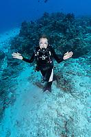 Sylvia Earle posing underwater in Seychelles