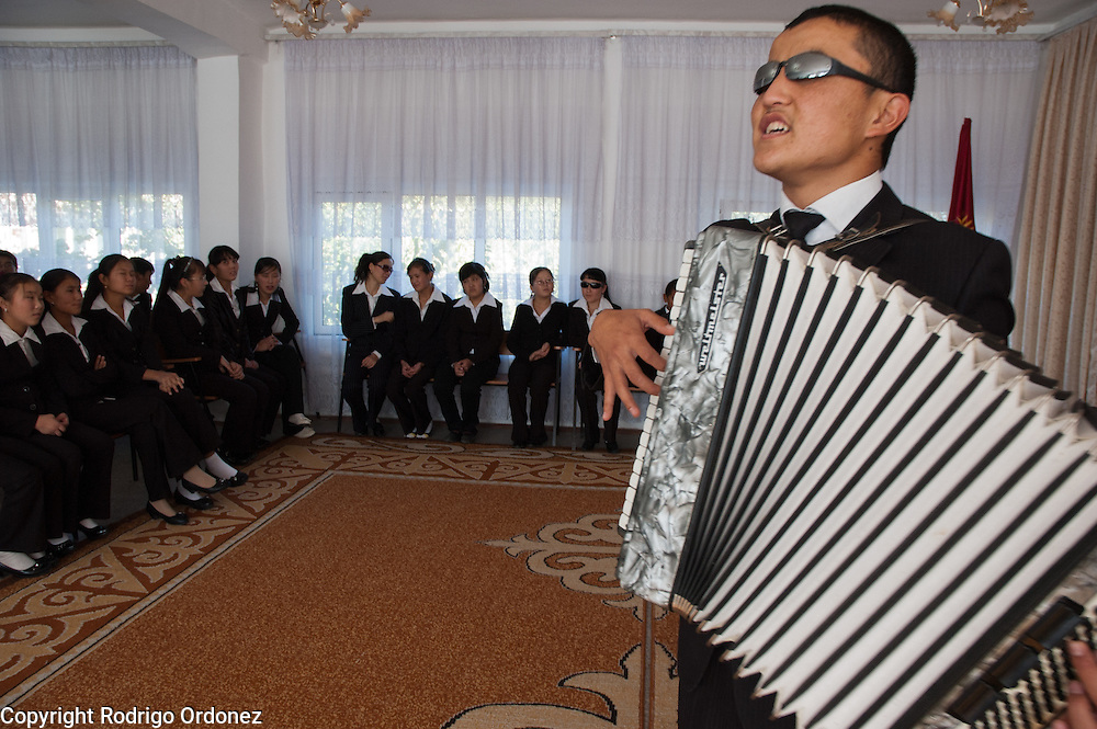 Ulan Osmon-Uulu, 19, plays the accordion and sings during the opening ceremony of a child-friendly space supported by Save the Children at Secondary School for the Blind, in Osh (Kyrgyzstan). At this boarding school, children with and without impaired vision study together.