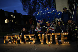 © Licensed to London News Pictures. 10/12/2018. London, UK. Anti-Brexit protesters with an illuminated People's Vote sign in Westminster as Theresa May delivers a statement on exiting the EU in Parliament. Photo credit: Rob Pinney/LNP