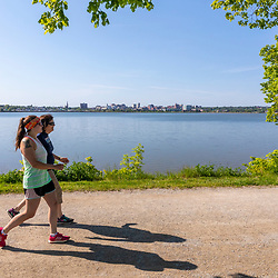 Two women walking on the Back Cove Trail next to Back Cove in Portland, Maine.