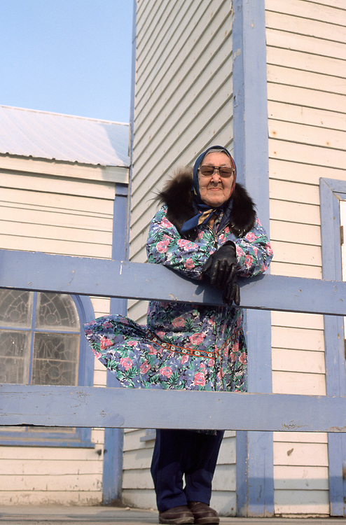 Amy Okpeaha stands outside the Presbiterian Church while waiting for the service in Iñupiaq to begin. The church is over a hundred years-old.<br /> <br /> May 18, 19:20