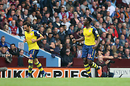 Danny Welbeck of Arsenal (right) celebrates scoring his side's second goal. Barclays Premier league match, Aston Villa v Arsenal at Villa Park in Birmingham on Saturday 20th Sept 2014<br /> pic by Mark Hawkins, Andrew Orchard sports photography.