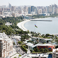 Baku, Azerbaijan, 26 July 2012<br /> View of the city and the seafront.<br /> Baku is the capital and largest city of Azerbaijan, as well as the largest city on the Caspian Sea and of the Caucasus region. It is located on the southern shore of the Absheron Peninsula, which projects into the Caspian Sea. <br /> The city consists of two principal parts: the downtown and the old Inner City (21.5 ha). <br /> Baku's urban population at the beginning of 2009 was estimated at just over two million people. Officially, about 25 percent of all inhabitants of the country live in the metropolitan city area of Baku.<br /> Photo: Ezequiel Scagnetti