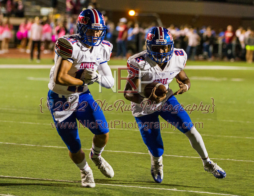 Daniel Hishaw Jr. (#2) carries the ball in for Moore Lions touchdown in at the end of the second quarter.