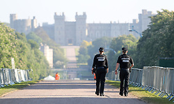 Two police officers make their way down the Long Walk in Windsor, as the clean-up continues after the royal wedding.