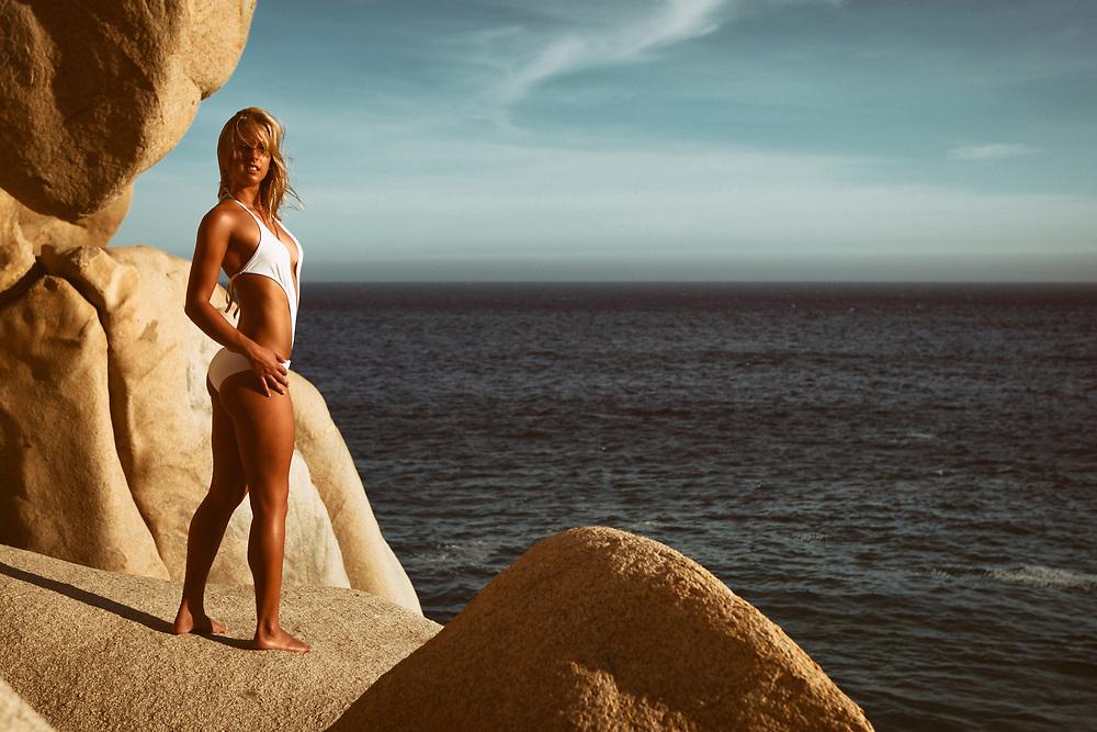 Swimsuit model in scenic coastal landscape in Cabo San Lucas, Mexico. ©justinalexanderbartels.com