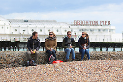 © Licensed to London News Pictures. 20/05/2015. Brighton, UK. A handful of people take advantage of the sunshine by relaxing on the beach in Brighton over Lunchtime, today May 20th 2015. Photo credit : Hugo Michiels/LNP