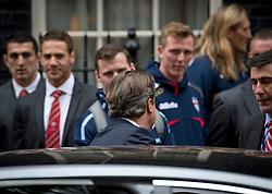 © London News Pictures. 31/10/2012. London, UK.  British Prime Minister DAVID CAMERON (back to camera) leaving number 10 Downing Street on October 31, 2012.  Photo credit: Ben Cawthra/LNP