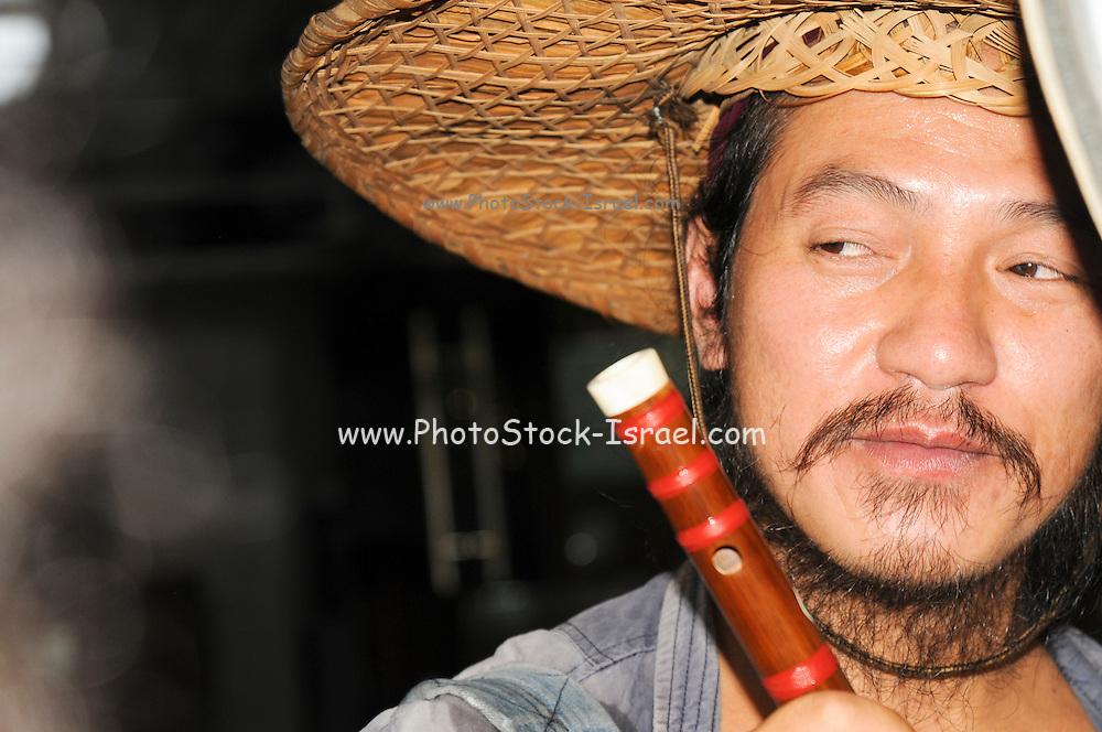 China, Guilin, Yangshuo Portrait of a local man