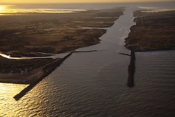the East cut at Port Mansfield connects the Gulf of Mexico in the foreground with the Laguna Madre behind the barrier island