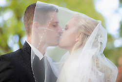 Close-up of a bride and groom kissing under veil, Ammersee, Upper Bavaria, Bavaria, Germany