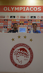 August 1, 2017 - Athens, Attiki, Greece - Stefano Kapino (left) goalkeeper of Olympiacos FC and Besnik Hasi (right) coach of Olympiacos FC  during the press conference for the 3rd Qualifying Round of UEFA Champions League against FK Partizan. (Credit Image: © Dimitrios Karvoutnzis/Pacific Press via ZUMA Wire)