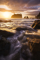 Crashing waves and warm light at sunset on Ruby Beach, Olympic National Park, Washington, USA