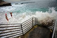 Swimmers enjoy 60-degree water in La Jolla Cove on December 21.