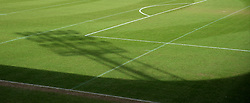 The shadow of a floodlight on the pitch at the Keepmoat Stadium
