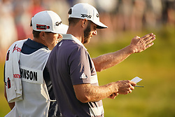 June 16, 2018 - Southampton, NY, USA - Dustin Johnson and caddie Austin Johnson on the 18th green during the third round of the 2018 U.S. Open at Shinnecock Hills Country Club in Southampton, N.Y., on Saturday, June 16, 2018. (Credit Image: © Brian Ciancio/TNS via ZUMA Wire)