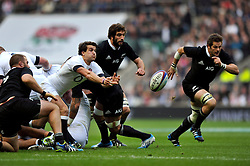 Lee Dickson (England) passes the ball back - Photo mandatory by-line: Patrick Khachfe/JMP - Tel: Mobile: 07966 386802 16/11/2013 - SPORT - RUGBY UNION -  Twickenham Stadium, London - England v New Zealand - QBE Autumn Internationals.