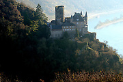 Oberes Mittelrheintal / Upper Middle Rhine Valley <br /> <br /> The Rhine Gorge is a popular name for the Upper Middle Rhine Valley, a 65 km section of the River Rhine between Koblenz and Bingen in Germany. It was added to the UNESCO list of World Heritage Sites in June 2002 for a unique combination of geological, historical, cultural and industrial reasons.<br /> <br /> The region's rocks were laid down in the Devonian period and are known as Rhenish Facies. This is a fossil-bearing sedimentary rock type consisting mainly of slate. The rocks underwent considerable folding during the Carboniferous period. The gorge was carved out during a much more recent uplift to leave the river contained within steep walls 200 m high, the most famous feature being the Loreley.<br /> <br /> On the photo:  Katz Castle (German: Burg Katz) is a castle above the German town of St. Goarshausen in Rhineland-Palatinate. This magnificent castle stands on a ledge looking downstream from the riverside at St. Goar. It was first built around 1371 by Count Wilhelm II of Katzenelnbogen. The castle was bombarded in 1806 by Napoleon and rebuilt in the late 19th century, between 1896-98.