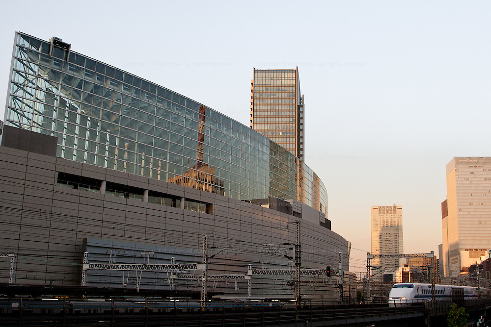 A JR 300 class shinkansen bullet train passing in front of the Tokyo International Forum in Yurakucho, Tokyo, Japan, Wednesday November 21st 2007