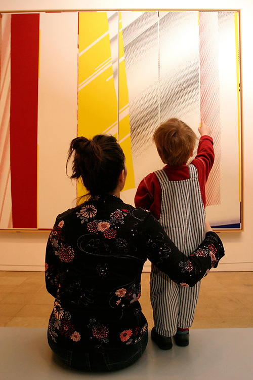 Toddler & woman looking at modern painting in Tate Modern Bankside London UK