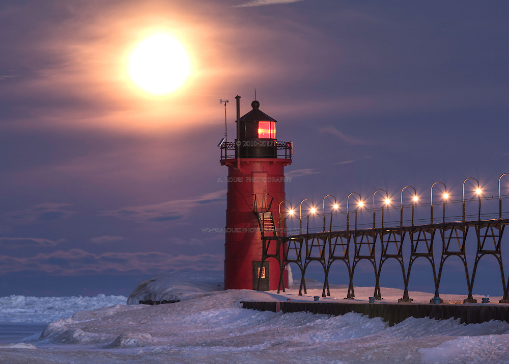The full moon beginning to make its decent towards a frozen Lake Michigan.  This image was featured by Fox 17 and Channel 3 News.