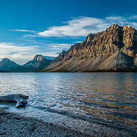 Crowfoot Mountain looms above Bow Lake in Banff National Park, Alberta, Canada. In the background are Mount Andromache, Mount Hector, Bow Peak and Bow Crow Peak.
