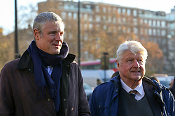 © Licensed to London News Pictures. 04/12/2019. London, UK. Parliamentary Conservative candidate for Richmond Park and North Kingston and former Tory candidate for Mayor of London ZAC GOLDSMITH (L) and  Author and father of the Prime Minister BORIS JOHNSON, STANLEY JOHNSON (R) attend the unveiling of life-sized herd of 21 bronze elephants at Marble Arch. The sculpture is the largest such depiction of an elephant herd in the world and is intended to draw attention to the plight of this species that could be extinct on current trends, by 2040. Each elephant in the sculpture is modelled after a real orphaned animal currently in the care of the Sheldrick Wildlife Trust. Left behind by poachers and other sources of human-wildlife conflict these animals have been raised by the trust in an effort to secure the future of the species. The herd will be displayed until 4 December 2020. Photo credit: Dinendra Haria/LNP