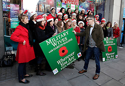 © Licensed to London News Pictures. 20/12/2011. London, United Kingdom .Gareth Malone with the Military Wives Choir outside of HMV on Oxford Street to celebrate the success of the Military Wives single..Photo credit : Chris Winter/LNP