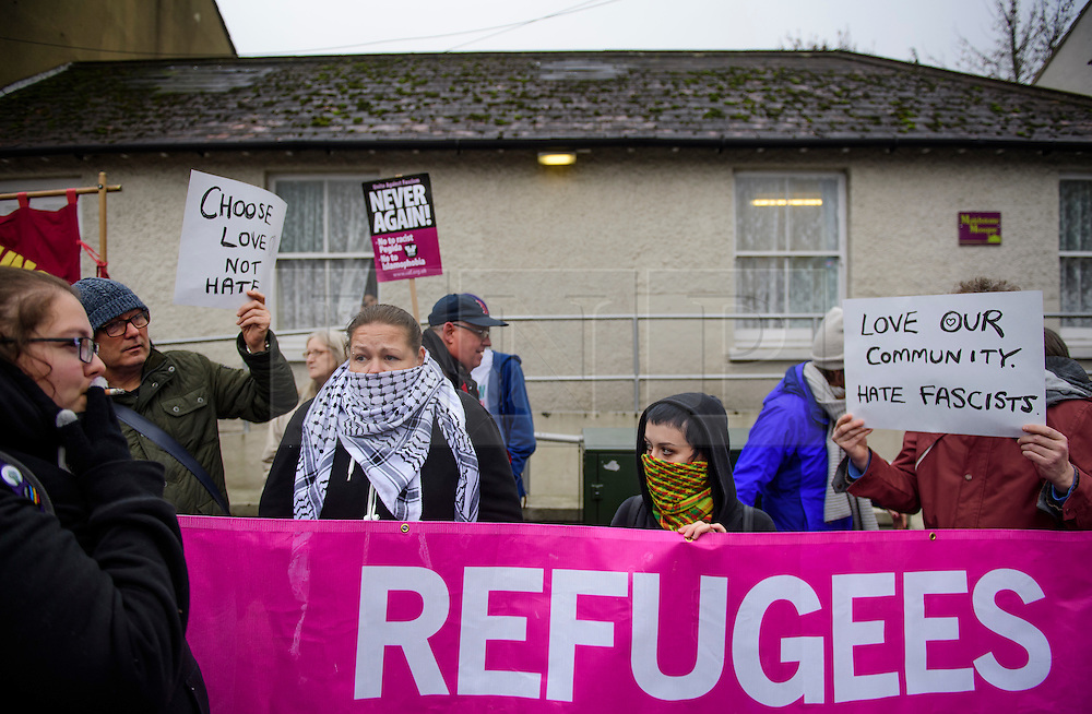 © Licensed to London News Pictures. 07/01/2017. London, UK. Campaigners join a counter demonstration organised by Kent Anti-Racism Network against a far-right protest by The South East Alliance against the expansion of Mote Road Islamic centre mosque in Maidstone, Kent. Plans to redevelop Maidstone Mosque into a purpose-built centre with three shops have been approved by  Maidstone Borough Council. A counter demonstration is Organised by The Kent Anti-Racism Network. . Photo credit: Ben Cawthra/LNP