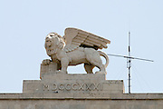 Israel, West Jerusalem, Winged lion statue on Generali building in Jaffa Street. The lion is the symbol of St. Mark, the patron saint of Venice. The building, was constructed in 1934-35 for the offices of the Italian Generali insurance company.