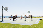 Guys Playing Basketball at Main Beach Laguna