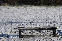 Bench and snow, Kilbogget Park in suburban in Dublin Ireland