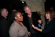Pauline Malefane; Alan Rickman, The opening night of The Mysteries Ð Yiimimangaliso at the Garrick Theatre. Aftershow party in The Crypt, St Martin-in-the-Fields, Trafalgar Square, London. 15 September 2009.<br /> Pauline Malefane; Alan Rickman, The opening night of The Mysteries ? Yiimimangaliso at the Garrick Theatre. Aftershow party in The Crypt, St Martin-in-the-Fields, Trafalgar Square, London. 15 September 2009.