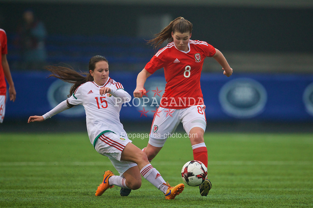 MERTHYR, WALES - Tuesday, February 14, 2017: Wales' Alice Griffiths in action against Hungary's Dorner Dóra during a Women's Under-17's International Friendly match at Penydarren Park. (Pic by Laura Malkin/Propaganda)