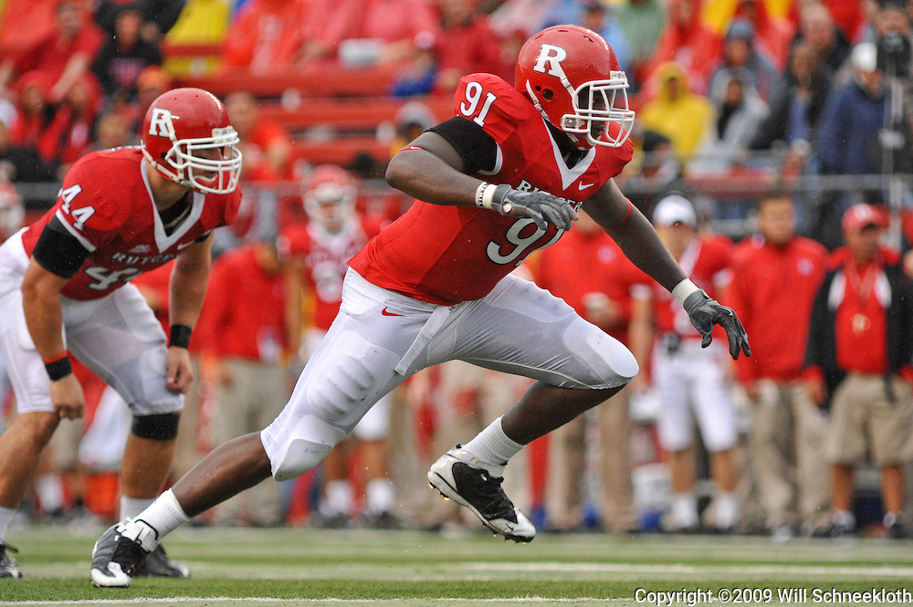 Sep 12, 2009; Piscataway, NJ, USA; Rutgers defensive lineman Justin Francis (91) attacks the Howard offensive line during the first half of Rutgers' 45-7 victory over Howard in NCAA College Football at Rutgers Stadium.