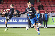 AFC Wimbledon midfielder Mitchell (Mitch) Pinnock (11) warming up during the EFL Sky Bet League 1 match between AFC Wimbledon and Gillingham at the Cherry Red Records Stadium, Kingston, England on 23 March 2019.