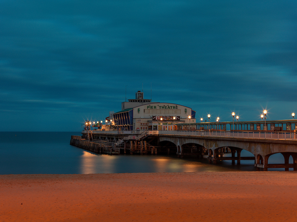 Editions of 8<br /> Dusk lighting creates moody ambience on the South Side of the Bournemouth Pier in the United Kingdom