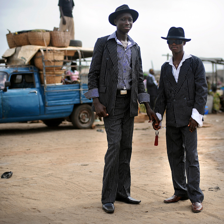 The 'sapeurs' or 'Sapes' are a subculture of men who derive their lifestyle and sense of well-being on being elegant and wearing fine French clothing in Cotonou, Benin March 1, 2008..