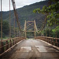 A rickety old suspension bridge in rural Guatemala, Cahaboncito Bridge, in Panzós, Alta Verapaz.