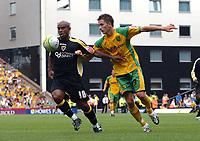 Photo: Ashley Pickering.<br /> Norwich City v Cardiff City. Coca Cola Championship. 01/09/2007.<br /> Trevor Sinclair of Cardiff (L) holds off Adam Drury of Norwich