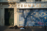 """April, 9th 2020 - Paris, Ile-de-France, France: Emmaus charity shop closed during Coronavirus in first month of near total lockdown imposed in France. A week after President of France, Emmanuel Macron, said the citizens must stay at home for at least 15 days, that has been extended. He said """"We are at war, a public health war, certainly but we are at war, against an invisible and elusive enemy"""". All journeys outside the home unless justified for essential professional or health reasons are outlawed. Anyone flouting the new regulations is fined. Nigel Dickinson"""
