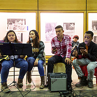 Left to right, University of New Mexico Gallup (UNM-Gallup) students Marie Ruiz, Jo Apura, Aaron Alejo and Donario Binns-Wallace perform inside Gurley Hall during their holiday celebration, Thursday, Dec. 6 at UNM-Gallup. The students are part of the Art Student Collective and volunteered to perform together during the celebration.