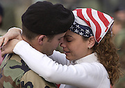 An Arkansas National Guard solider says goodbye to his wife before deploying to Iraq in 2003.