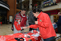 A young fan looks at Bristol City items at Cabot Circus - Photo mandatory by-line: Dougie Allward/JMP - Mobile: 07966 386802 - 11/03/2015 - SPORT - Football - Bristol - Cabot Circus Shopping Centre - Johnstone's Paint Trophy