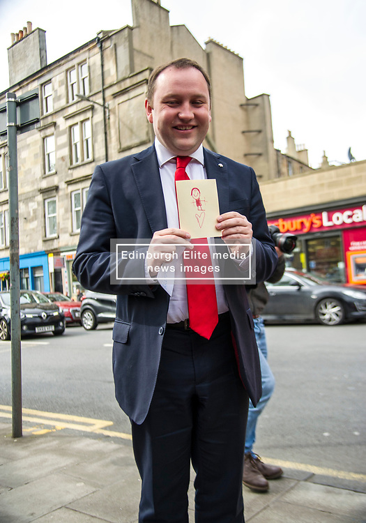 Pictured: Ian Murray received a good luck card from Daniel Jonhston's five year old daughter Fraya at the launch. Young Fraya was too shy to go on camera.<br /> <br /> Scottish Labour's Ian Murray and Scottish Labour leader Kezia Dugdale hit the general election campaign trail in Edinburgh today for the first campaign event of Mr Murray's re-election campaign for the Edinburgh South constituency.<br /> Ger Harley   EEm 21 April 2017