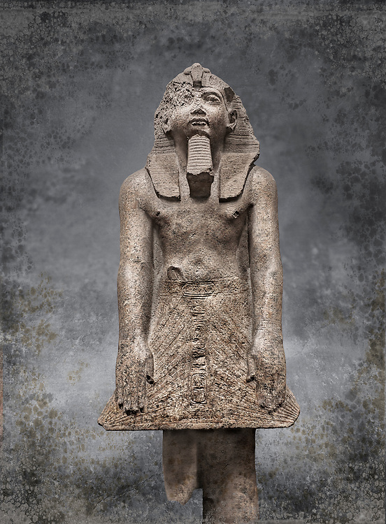 Ancient Egyptian statue of Ramesses II , granite, New Kingdom, 18th Dynasty, (1500-1400 BC, Karnak, Temple of Mut. Egyptian Museum, Turin. <br /> <br /> The statue depicting Ramesses II  was reworked over a statue of an earlier pharaoh. This can be seen around the corners of the mouth which show reworking. The roundness of the face and short apron also point to an earlier style.  Ramesses II is depicted praying with his arms out straight and his hands resting flat on the apron of his kilt.