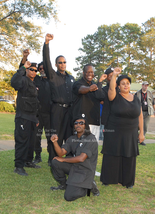 Members of Ther Black Panthers gather for a photo outside the LaSalle Parish court house in Jena, Louisana Wednesday Sept 19 ,2007. The Black Panthers lead by Malik Shabazz, center with sunglasses, arrived in Jena to help with security for the raly on friday. Thousands are expected to gather here to protest for six black youths that were wrongly arrested. (Photo/© Suzi Altman)