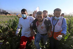 June 16, 2017 - Gaza City, Gaza Strip, Palestinian Territory - Palestinian protesters carry a wounded man during clashes with Israeli security forces following a demonstration against the blockade on the Gaza Strip, near the border fence east of Jabalia refugee camp on June 16, 2017  (Credit Image: © Yasser Qudih/APA Images via ZUMA Wire)