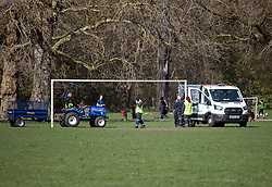 © Licensed to London News Pictures. 29/03/2021. London, UK. Football goal posts being erected in Battersea Park, south London, on the day that some lockdown restrictions are eased. Photo credit: Ben Cawthra/LNP